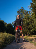 Mountain bike cyclist riding at sunrise healthy lifestyle doing Stock Image