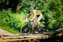 Mountain Bike cyclist riding track at sunny day Stock Photo