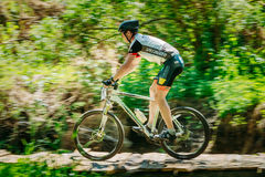 Mountain Bike cyclist riding track at sunny day. GOMEL, BELARUS - JUNE 7, 2015: Mountain Bike cyclist riding track at sunny day, healthy lifestyle active athlete Stock Photos