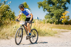 Mountain Bike cyclist riding track at sunny day, healthy lifesty Stock Photography