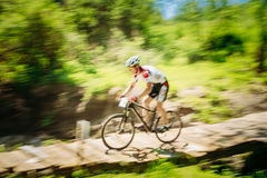 Mountain Bike cyclist riding track at sunny day Stock Images