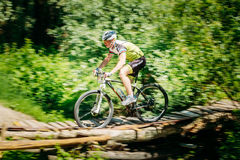 Mountain Bike cyclist riding track at sunny day, healthy lifestyle Stock Photography