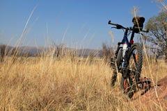 Mountain bike in field Stock Photos