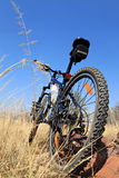 Mountain bike in field Stock Photos