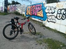 Mountain bike in front of graffiti wall Stock Images