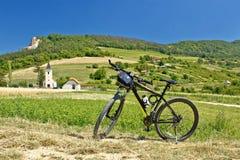 Mountain bike in green landscape Stock Photo