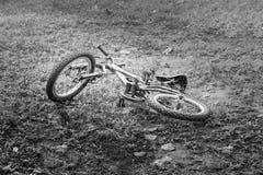 Mountain bike on the ground, image black and white.  stock photos