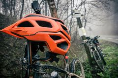 Mountain bike and helmet in autumn woods Royalty Free Stock Image