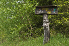 Mountain bike and hiking trail signpost Stock Photo