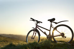 Mountain bike on a hill at sunrise Royalty Free Stock Photo