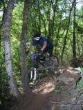Mountain bike jump 11. Racing mountain bike zooming past 11 Stock Image