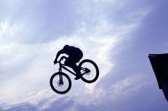 Mountain bike jumper. Extreme mountain bike jumper in big jump Stock Photos