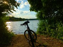 Mountain Bike By A Lake. A mountain bike parked by a lake lookout Royalty Free Stock Photography