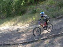Mountain bike motion. Racing mountain bike zooming past 8 Royalty Free Stock Photos