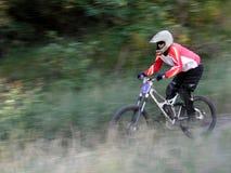 Mountain bike motion blur. Racing mountain bike zooming past 5 royalty free stock image