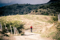 Mountain bike MTB rider on country road, track trail in inspirat Royalty Free Stock Images