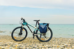 Mountain bike parked on the beach. Stock Photo