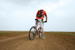 Mountain bike race on ground road Royalty Free Stock Images