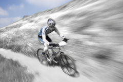 Mountain bike racer. Photo of a mountain bike racer with elective coloring Stock Photo
