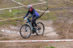 Mountain bike racer. Mountain bike contest on unfinished construction. First edition of Urban Trail Cross Country Short Circuit - XCC inside of Romexpo Stock Images