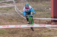 Mountain bike racer. Mountain bike contest on unfinished construction. First edition of Urban Trail Cross Country Short Circuit - XCC inside of Romexpo royalty free stock images