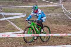 Mountain bike racer. Mountain bike contest on unfinished construction. First edition of Urban Trail Cross Country Short Circuit - XCC inside of Romexpo Stock Photo