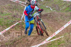 Mountain bike racer. Mountain bike contest on unfinished construction. First edition of Urban Trail Cross Country Short Circuit - XCC inside of Romexpo stock image