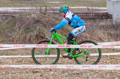 Mountain bike racer. Mountain bike contest on unfinished construction. First edition of Urban Trail Cross Country Short Circuit - XCC inside of Romexpo royalty free stock image