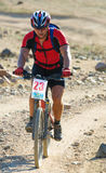 Mountain bike racer in desert Stock Photography