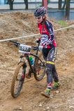 Mountain bike racer with mud. Mountain bike contest on unfinished construction. First edition of Urban Trail Cross Country Short Circuit - XCC inside of Romexpo royalty free stock images