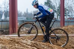 Mountain bike racer with mud. Mountain bike contest on unfinished construction. First edition of Urban Trail Cross Country Short Circuit - XCC inside of Romexpo stock images