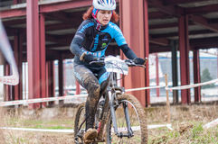Mountain bike racer with mud. Mountain bike contest on unfinished construction. First edition of Urban Trail Cross Country Short Circuit - XCC inside of Romexpo royalty free stock photo