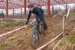 Mountain bike racer with mud. Mountain bike contest on unfinished construction. First edition of Urban Trail Cross Country Short Circuit - XCC inside of Romexpo stock photos