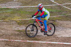 Mountain bike racer on mud. Mountain bike contest on unfinished construction. First edition of Urban Trail Cross Country Short Circuit - XCC inside of Romexpo royalty free stock image
