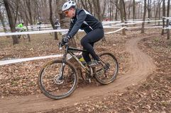 Mountain bike racer on mud. Mountain bike contest on unfinished construction. First edition of Urban Trail Cross Country Short Circuit - XCC inside of Romexpo stock photography