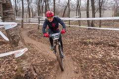 Mountain bike racer on mud. Mountain bike contest on unfinished construction. First edition of Urban Trail Cross Country Short Circuit - XCC inside of Romexpo royalty free stock photography
