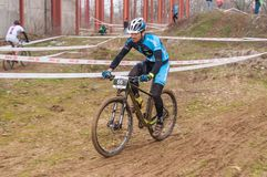 Mountain bike racer on mud. Mountain bike contest on unfinished construction. First edition of Urban Trail Cross Country Short Circuit - XCC inside of Romexpo stock image