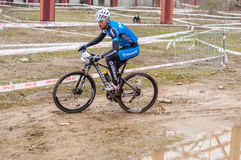 Mountain bike racer on mud. Mountain bike contest on unfinished construction. First edition of Urban Trail Cross Country Short Circuit - XCC inside of Romexpo royalty free stock photo