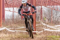 Mountain bike racer on mud. Mountain bike contest on unfinished construction. First edition of Urban Trail Cross Country Short Circuit - XCC inside of Romexpo stock photo