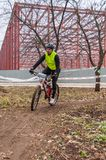 Mountain bike racer on mud Royalty Free Stock Images