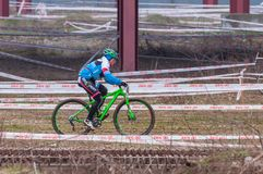 Mountain bike racer on mud. Mountain bike contest on unfinished construction. First edition of Urban Trail Cross Country Short Circuit - XCC inside of Romexpo Stock Photos