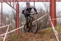 Mountain bike racer on mud Stock Images