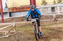 Mountain bike racer on mud Royalty Free Stock Photos