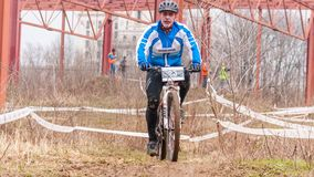 Mountain bike racer on mud Stock Photos