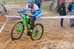Mountain bike racer on sand. Mountain bike contest on unfinished construction. First edition of Urban Trail Cross Country Short Circuit - XCC inside of Romexpo stock images