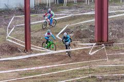 Mountain bike racers on mud. Mountain bike contest on unfinished construction. First edition of Urban Trail Cross Country Short Circuit - XCC inside of Romexpo Royalty Free Stock Image