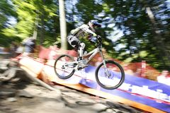 Mountain bike rider. A mountain bike rider in the air, motion blurred spectators in the background Stock Photo