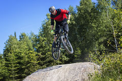 Mountain bike rider jumping kicker Royalty Free Stock Photo