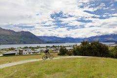 Mountain bike rider at Lake Wanaka royalty free stock photo