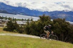 Mountain bike rider at Lake Wanaka stock photography